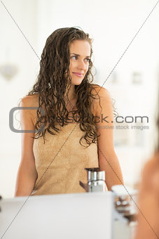 Portrait of young woman with wet hair in bathroom