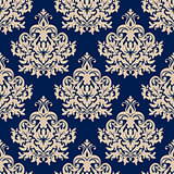 Blue damask seamless pattern with beige flourishes