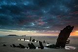 Beautiful dramatic sunset landscape over shipwreck on Rhosilli B