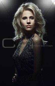 Portrait of elegant woman in low key.