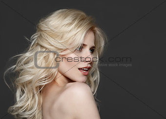 Portrait of beautiful young blond woman with clean face.