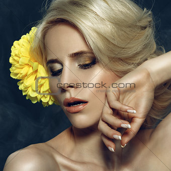 Beautiful Blonde Woman Touching her Face.