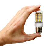 led lightbulb in the hand isolated on white