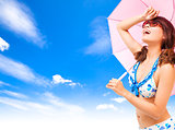 young woman raise hand to cover sunlight with a umbrella