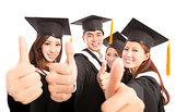 happy group graduate students thumbs up together