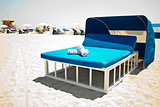 Luxurious beach bed with canopy on a sandy beach