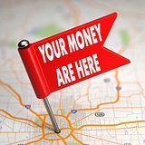 Your Money are Here - Small Flag on a Map Background.