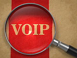 VOIP Magnifying Glass on Old Paper.