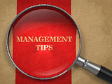 Management Tips Magnifying Glass on Old Paper.