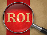 ROI - Magnifying Glass on Old Paper.