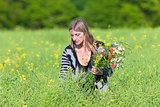 Woman Picking Wild Flowers on the Meadow