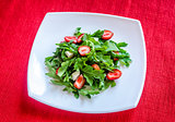 Salad rocket with fresh strawberries and mozzarella