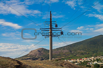 Power line pylon in the mountains.