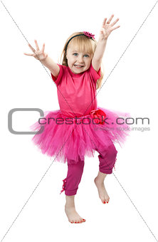 little girl in a pink dress dancing in studio