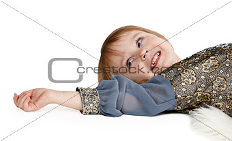 little girl lying on the floor in the studio