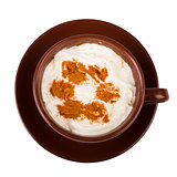 Coffee with whipped cream and cinnamon