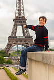 Cheerful teenager shows the Eiffel tower, France