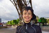 Cheerful teenager near the Eiffel Tower in Paris
