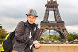 Young man hipster on the background of the Eiffel Tower, Paris