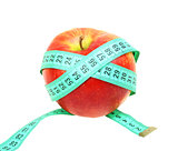 Measure tape on red apple