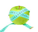 Measure tape on green apple
