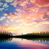 abstract nature background with sunrise on forest lake and cloud