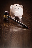 Gavel and Piggy Bank on Table