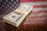 Thousands of Dollars with Reflection of American Flag on Table