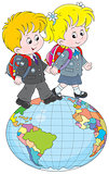 Schoolchildren going on a globe