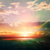 abstract nature background with sunrise and ocean