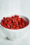 white bowl with goji berries on the table