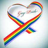 heart-shaped rainbow ribbon and text gay pride