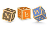Word NEW written with alphabet blocks