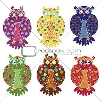 Set of six colourful funny owls over white