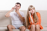 young couple phone sitting on couch