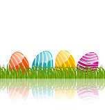 Easter traditional painted eggs in green grass with empty space