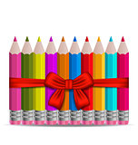 Set colorful pencils decorated by bow on white background