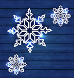 Set snowflakes on wooden background