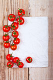 fresh cherry tomatoes and piece of paper