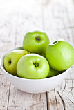 ripe green apples in bowl