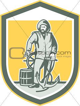 Fisherman Holding Anchor Wheel Shield Retro