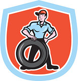 Tireman Mechanic With Tire Cartoon Shield