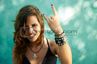 Portrait of young woman in heavy metal style