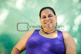 Portrait of fat woman looking at camera and smiling