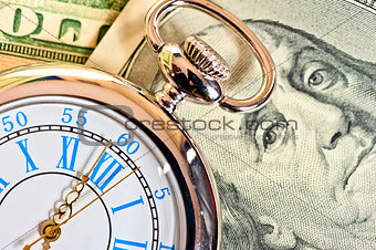 antique pocket watch on the dollar