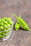 Green peas in a glass bowl