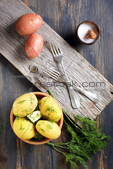 Potatoes, dill, salt shaker and forks.
