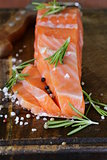 salty delicacy red salmon fish on wooden board