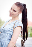 young attraktive happy woman outdoor in summer