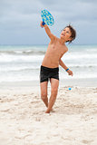 happy little child kid boy  playing beachball on beach in summer